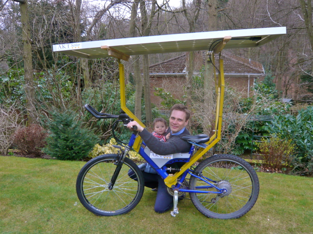 Simon, his son and the solar bike